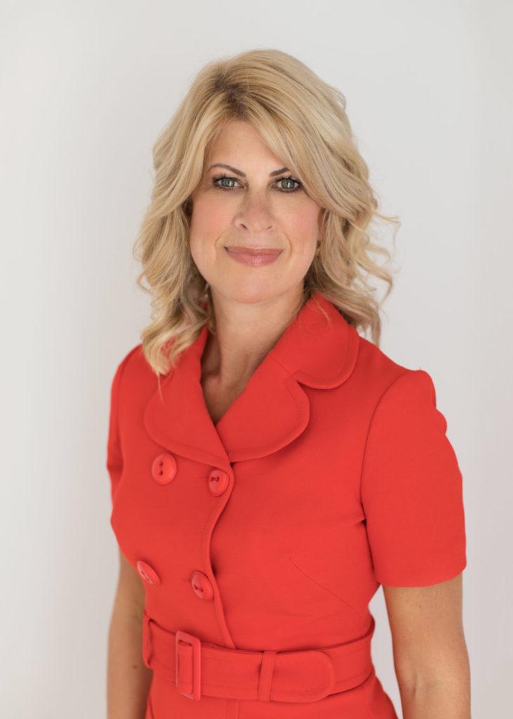 Beverley in smart red dress