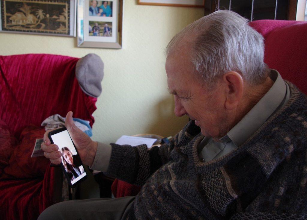 Elderly man on online call